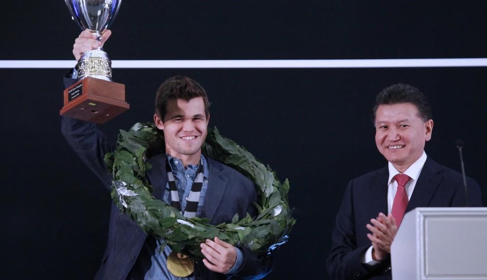 World Champion Magnus Carlsen lift trophy