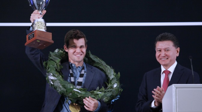 World Champion Magnus Carlsen lift trophy